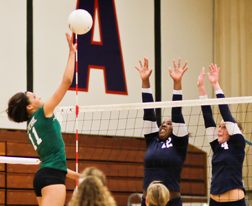 The Bearcats' Allie LaPierre returns the ball as the Minutemen's Skylar McLeod (12) and Kristina Newkirk (4) defend during a CIF Playoff volleyball match between the Maranatha High School Minutemen and the visting Bonita High School Bearcats in Pasadena, CA on November 14, 2009.  (STAR/TRIB/Correspondent photo by David Thomas/SPORTS)