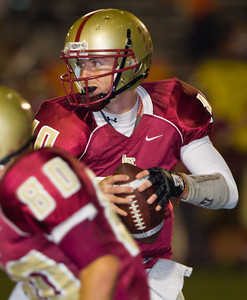 Spartans' Rocky Moore (10) falls back to pass during a football game between the La Canada High School Spartans and the visiting Monrovia High School Wildcats in La Canada, CA on November 6, 2009.  (STAR-NEWS/Correspondent photo by David Thomas/SPORTS)