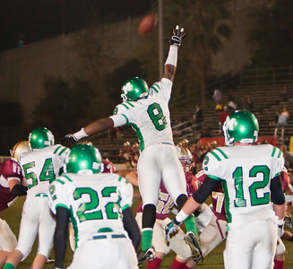 Wildcats' Ellis McCarthy (8) leaps to try and block an extra point attempt during a football game between the La Canada High School Spartans and the visiting Monrovia High School Wildcats in La Canada, CA on November 6, 2009.  (STAR-NEWS/Correspondent photo by David Thomas/SPORTS)