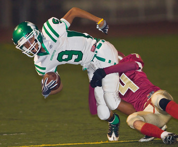 Wildcats' Jay Henderson (9) is brought down after a catch by the Spartans' Scott Stetson (4) during a football game between the La Canada High School Spartans and the visiting Monrovia High School Wildcats in La Canada, CA on November 6, 2009.  (STAR-NEWS/Correspondent photo by David Thomas/SPORTS)