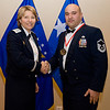 United States Air Force Maj. Gen. Michelle D. Johnson, Deputy Chief of Staff, Operations and Intelligence, SHAPE, Belgium presents Master Sgt. Alejandro A. Rull, NATO Airborne Early Warning and Control Force Command, SHAPE, Belgium with his medallion prior to the Annual Air Force Awards Banquet on SHAPE Feb. 22. Rull was nominated for Senior NCO of the Year. (NATO photo by U.S. Army Sgt. 1st Class VeShannah J. Lovelace)