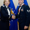 United States Air Force Maj. Gen. Michelle D. Johnson, Deputy Chief of Staff, Operations and Intelligence, SHAPE, Belgium presents Staff Sgt. Matthew T. Kuchera, NATO Communication Information Systems Services Agency, Sector Mons, SHAPE, Belgium with his medallion prior to the Annual Air Force Awards Banquet on SHAPE Feb. 22. Kuchera was nominated for NCO of the Year. (NATO photo by U.S. Army Sgt. 1st Class VeShannah J. Lovelace)