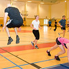 Members of the SHAPE Community participate in Circuit Training at the post gym led by British Royal Air Force Corporal Steve Furness, Physical Training Instructor April 5. (NATO photo by U.S. Army Sgt. 1st Class VeShannah J. Lovelace). (