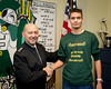 SACEUR, Adm. James Stavridis presents coins to the SHAPE cross country team at the SHAPE International High School. Jan. 28, 2013. <br /> (photo by RNLAF Sgt. Peter Buitenhuis)
