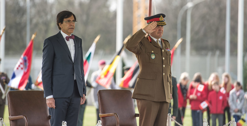 SHAPE celebrates 50 years in Mons<br /> <br /> Deputy Supreme Allied Commander Europe, General Sir James Everard with the Mayor of Mons Elio Di Rupo, salutes the colours during the 50th Anniversary of SHAPE in Mons celebration, March 31, 2017. (NATo Photo by Sgt. 1st Class Stefan Hass – DEUA)