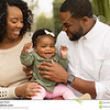 http://www.dreamstime.com/stock-image-happy-african-american-family-their-baby-playing-laughing-daughter-image83374951