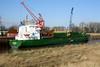 SKARPOE (Limassol) - IMO9325142 - Cargo - CYP/4508/05 Scheeps Bodewes, Hoogezand, No.634 - 89.9 x 15.2 - H Buss, Leer - Port Sutton Bridge, unloading loose peat, 02/03/10.