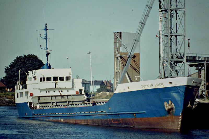 TUSKAR ROCK (Dublin) - IMO7604831 - Cargo - IRL/1720/78 Hancocks Shipbuilders, Pembroke Dock, No.CD1 - 68.0 x 11.6 - Coal Distributors Ltd. - 05/10 broken up - Boston, loading grain on the riverside wharf, 08/82.