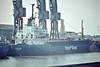 VAERMLAND (Hamburg) - IMO7628677 - Cargo - DEU/2052/77 Nishi Zosensho, Imabari, No.183 - 79.2 x 12.4 - Boston, unloading steel, 02/83.