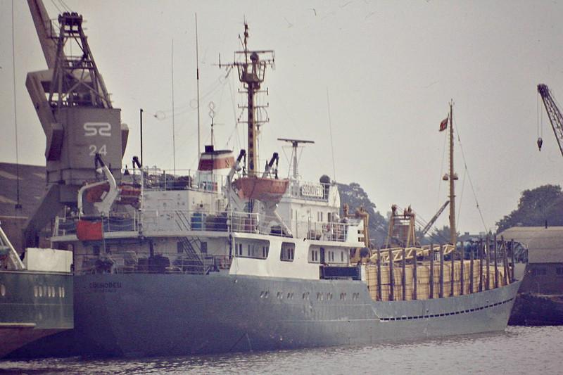 SOSNOVETS (Leningrad) - IMO7108033 - Cargo - RUS/1828/70 Constanta Shipyard, Romania, No.338 - 80.2 x 11.9 - still trading as SEAWAY - Kings Lynn, waiting for a berth to unload timber in Bentinck Dock, 08/84.