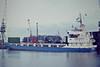 SUDERELV (Hamburg) - IMO7726952 - Cargo - DEU/2418/78 JJ Soetas Schiffswerft, Hamburg, No.849 - 79.8 x 12.8 - Jurgen Frommann - still trading as MALAK TRADER (TNZ) - Boston, unloading steel, 01/83.