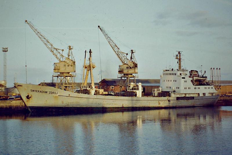 SWIERADOW ZDROJ (Szczecin) - IMO7224265 - Cargo - POL/1920/72 Drobeta Shipyard, Romania - 85.9 x 12.4 - 06/86 broken up at Hamina - Kings Lynn, unloading timber, 01/84 - note that mainmast has been removed.