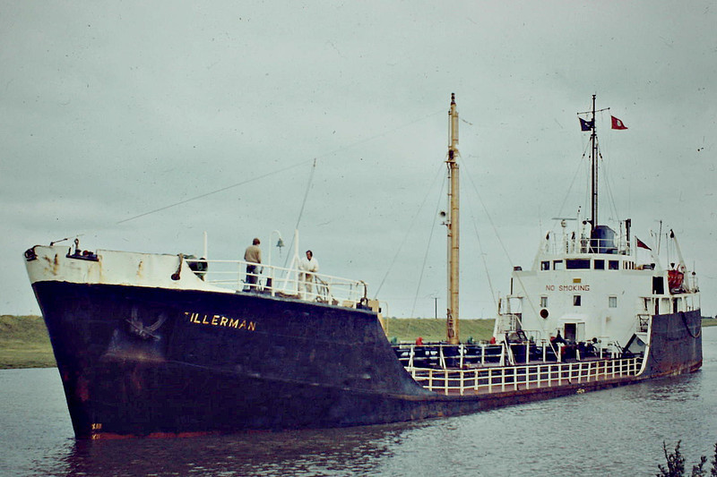 TILLERMAN (London) - IMO5409433 - Tanker - GBR/1191/63 Drypool Engineering Co., Hull, No.5 - 61.9 x 9.4 - Rowbotham Tankships - still trading as TILLERMAN - Wisbech, approaching the Swinging Berth, 07/84.