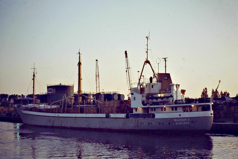 WILHELM I (Elsfleth) - IMO6620278 - Cargo - DEU/1300/66 Schulte & Bruns, Emden, No.228 - 70.0 x 11.0 - Frank Wadepuhl KG - 11/09 broken up at Aliaga - Wisbech, going astern upriver, to unload timber, 10/84.