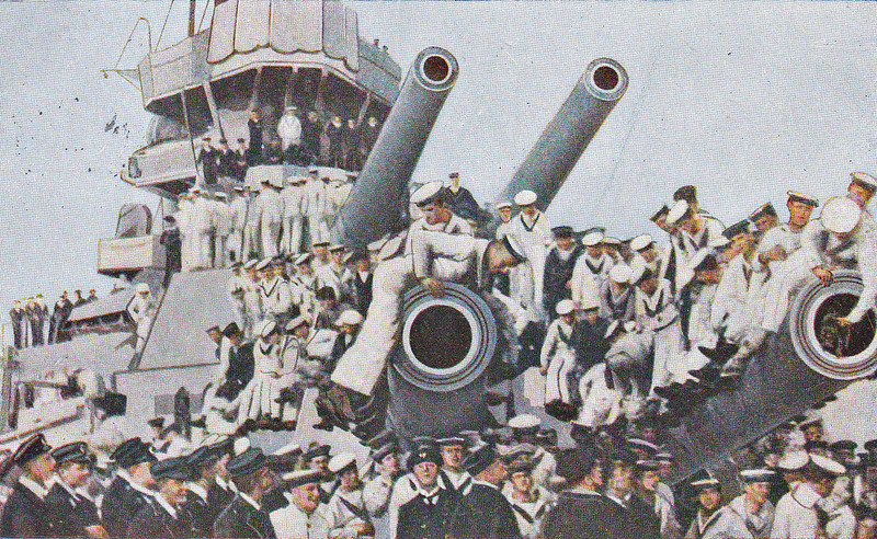16 - BIG GUNS AND OFFICERS AND CREW OF HMS QUEEN ELIZABETH - I'm fairly certain that this was not the idea of the ship's officers! - posted June 25th, 1916. Has the sailor on the far right put a dog in the gun barrel?