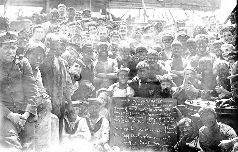 COALING SHIP - The crew of HMS VENERABLE celebrate the end of coaling ship at Gibraltar on Apirl 23rd, 1912. HMS VENERABLE was a Pre-Dresdnought battleship of the London Class.