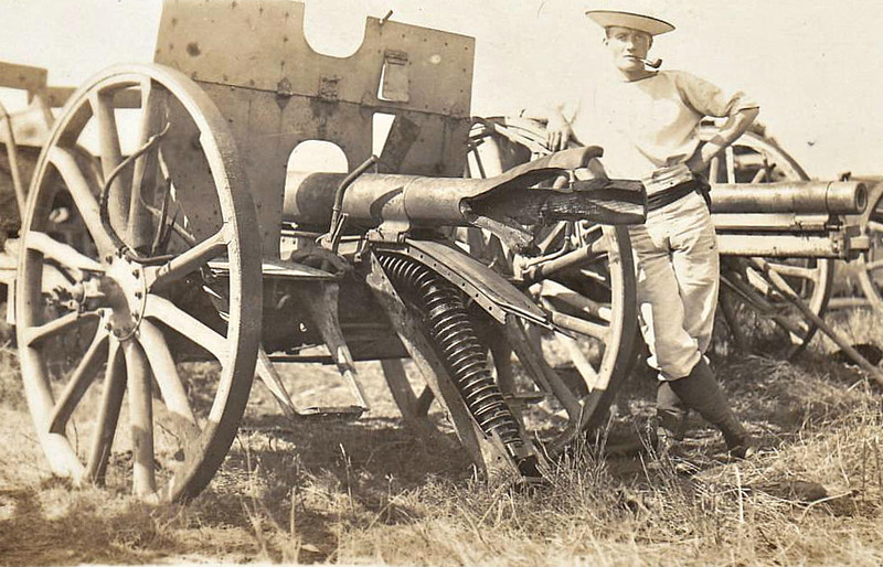 CAPTURED ARTILLERY - This very nattily dressed sailor examines captured field guns - this one won't be used again in a hurry!