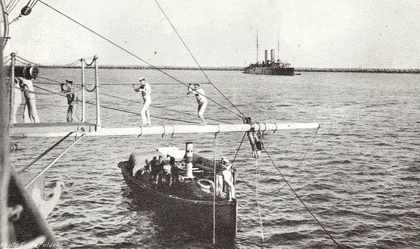 COMING OVER THE LOWER BOOM - getting aboard a Pre-Dreadnought Battleship form a small boat was evidently no easy or dignified process!