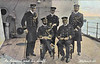 ADMIRAL AND HIS STAFF - Rear Admiral seated on the right with his Flag Captain sitting next to him with the telescope. The chap with the stick is the Flag Lieutenant, Flag commader in the middle - not sure about the chap on the right.