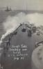 1909 - July - King Edward VII Class Battleship HMS BRITANNIA ships heavy seas over the bows whilst on Fleet Manoeuvres.