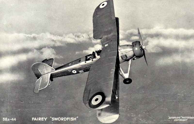 """1936 to 1946 - FAIREY SWORDFISH - The Fairey Swordfish was a torpedo bomber biplane used during the Second World War. Originating in the 1930s, the Swordfish, nicknamed """"Stringbag"""", was an outdated design by the start of the war in 1939, but remained in front-line service until VE Day, outliving several types intended to replace it. It was initially operated primarily as a fleet attack aircraft; during its later years it was used as an anti-submarine and training craft. The Swordfish achieved some spectacular successes, notably the sinking of one and damaging two battleships of the Italian Navy in the Battle of Taranto and the famous crippling of the Bismarck. After more modern torpedo attack aircraft were developed, the Swordfish was redeployed successfully in an anti-submarine role, armed with depth charges or eight 60lb rockets and flying from the smaller escort carriers, or even Merchant Aircraft Carriers when equipped for rocket-assisted takeoff. Its low stall speed and inherently tough design made it ideal for operation from the MAC carriers in the often severe mid Atlantic weather. Indeed, its takeoff and landing speeds were so low that it did not require the carrier to be steaming into the wind, unlike most carrier-based aircraft. On occasion, when the wind was right, Swordfish were flown from a carrier at anchor. Swordfish-equipped units accounted for 14 U-boats destroyed. The Swordfish was to be replaced by the Albacore, also a biplane, but outlived its intended successor and was succeeded by the Fairey Barracuda monoplane torpedo bomber. The last of 2,392 Swordfish aircraft was delivered in August 1944. Operational sorties continued in to January 1945 with anti-shipping operations off Norway, where the Swordfish's manoeuvrability was essential. The last operational squadron was disbanded on 21 May 1945, after the fall of Germany, and the last training squadron was disbanded in the summer of 1946."""