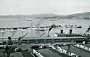 VALPARAISO HARBOUR with ships of the Chilean Navy at their moorings in the 1940's: the destroyers are the 6 ships of the Serrano Class, built by Thornycroft in 1927/8, armed with 3x120mm, decommissioned between 1958 and 1963 and the cruiser is O'HIGGINS, built by Armstrong & Co., Newcastle, in 1898 and decommissioned in 1958. She had been an inactive headquarters ship since 1933.