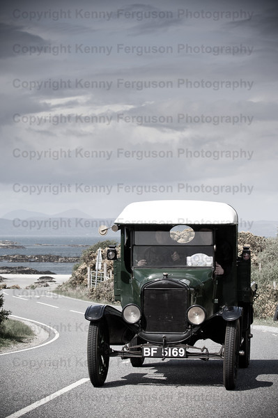 The model T Ford centenary celebration of the ascent of Ben Nevis.Started from the originla spot in the high street followed by various tours around the local landscape.Cars pictured on the road to the Isle's-beautiful scenic route with the best weather of the week