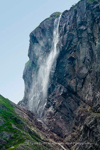 NEWFOUNDLAND - GROS MORNE NATIONAL PARK A waterfall cascades down a rock cliff in Western Brook Pond [grosmornewaterfall_0558]