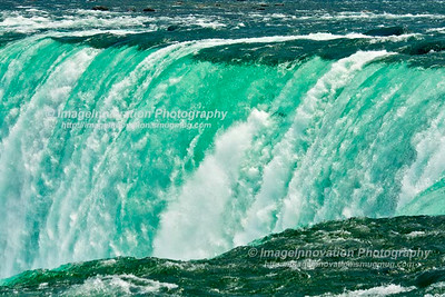 NIAGARA FALLS, ONTARIO CANADA Green water flows over the top of the Canadian falls [niagarafalls_2999]