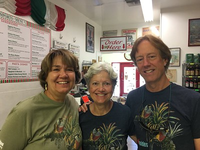 At each meeting, we cook for each other, but when out on the town, we put on our best t-shirts (Dan Lane's Toucan Barbets are on our latest) and patronize Arizona's poshest eateries! Here, Megan, Peggy, and Bret Whitney (the Kestrel, Puffin, & Kite) pick up lasagna for the masses.