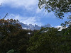 """Mt. Kinabalu, reaching 13,455', is the tip of an enormous granite batholith, only one tenth of which is exposed.  Geologically young--and still growing at 20 inches per century--dramatic Kinabalu dominates the landscape of northwestern Sabah. <div id=""""caption_tourlink"""" align=""""right""""> [photo © Hal Beecher]</div>"""