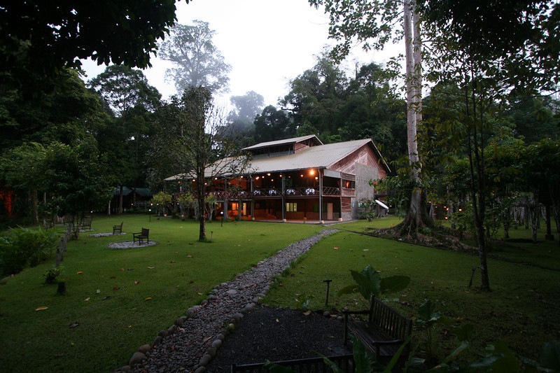 """Wonderfully situated, right in the midst of the rainforest, the main lodge building contains the open-air dining room... <div id=""""caption_tourlink"""" align=""""right""""> [photo © guide Richard Webster]</div>"""