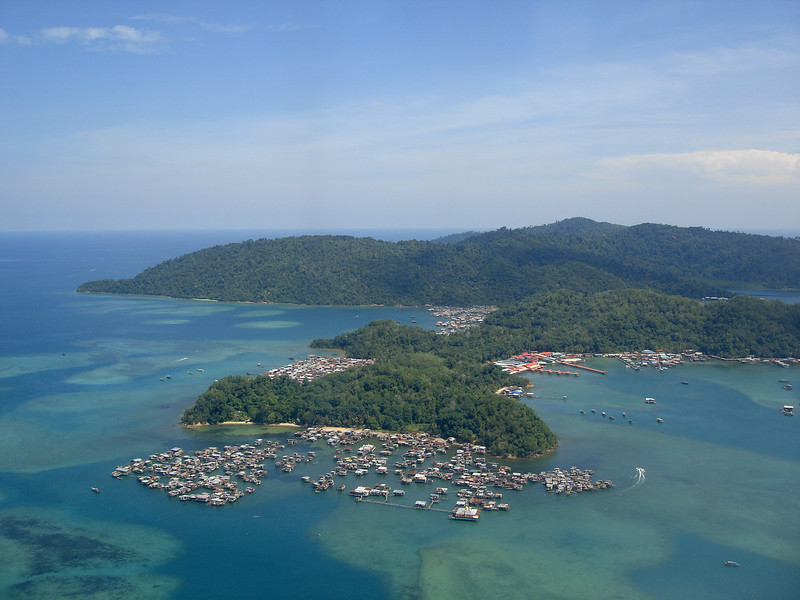 """Our first views of Borneo come from the air--forested islands in the South China Sea, just off the coast of Sabah. <div id=""""caption_tourlink"""" align=""""right""""> [photo © guide Rose Ann Rowlett]</div>"""