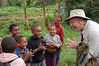 "Participant Jim Galleher teaches the kids some finger tricks in the highlands of New Guinea.  <div id=""caption_tourlink"" align=""right"">[photo © participant Jack Brown]</div>"