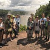 "Looking for cuckoos takes us to some pretty spectacular places. Here is one of our groups with guide Bret Whitney at Kaieteur Falls, Guyana. Bret quips: ""Look at those smiles, and they hadn't even seen Rufous-winged Ground-Cuckoo, Ocellated Crake, Red-and-black Grosbeak, Sun Parakeet, or Red Siskin yet!"" Photo by Bret Whitney, on a private tour based on our <a href=""https://fieldguides.com/bird-tours/guyana/"" target=""_blank""><span class=""slideshow_tourlink3"">GUYANA: WILDERNESS PARADISE</span></a> itinerary."