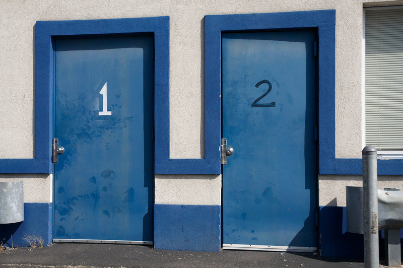 """"""" Blue, a heavenly color, blue denotes loyalty, a sense of calm, and wealth.<br /> Here we have two blue doors inviting you.  How irresistible."""" –Photograph by Penny Frondelli"""