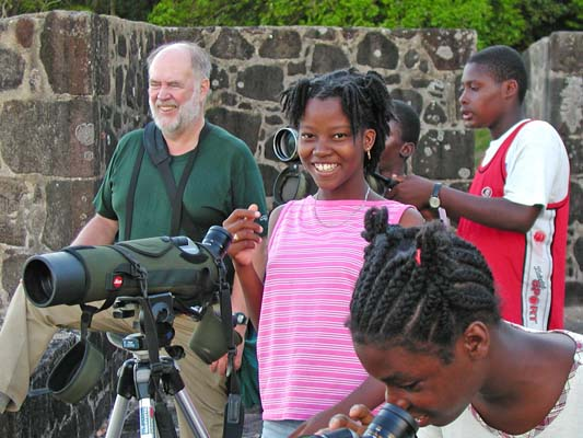 """The Lesser Antilles are fun birding. The islands are beautiful, the people friendly, and the birds fantastic. Like the Galapagos, this is a laboratory of evolution where you can experience species in the making. But overall it just is a fascinating, diverse, and enjoyable place to hold up your binoculars. Here we share the joy with local kids in Dominica, appropriately called the """"nature island."""" <div id=""""caption_tourlink"""" align=""""right""""> [photo © guide Alvaro Jaramillo]</div>"""
