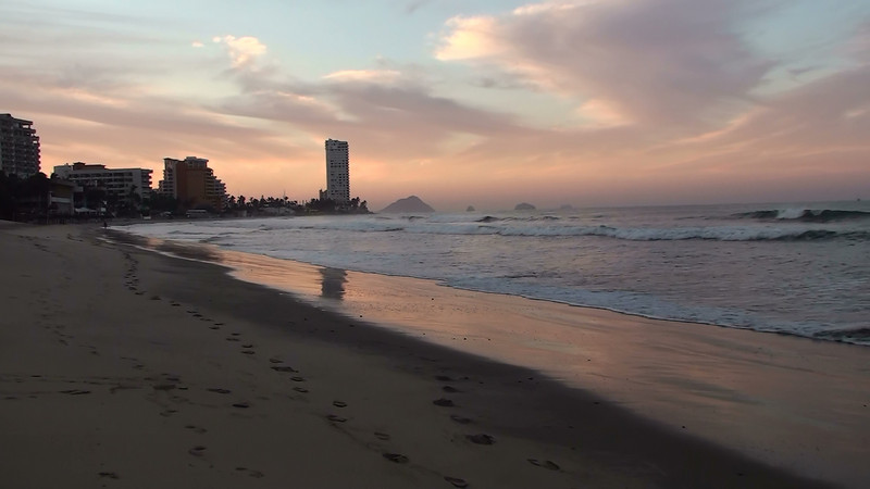 "The tour begins in Mazatlan, Mexico, in the state of Sinaloa.  Though quite touristy during certain times of the year, it has evident appeal (and beauty) in the early morning light. <div id=""caption_tourlink"" align=""right""> [video still © guide Jesse Fagan]</div>"