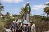 """Having seen the parrot, what better place for a group photo than below the big Bahama Parrot on Abaco Island! <div id=""""caption_tourlink"""" align=""""right""""> [Photo © guide Jesse Fagan]</div>"""