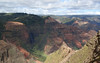 """On our return from the Alakai, we stopped for some views of dramatic Waimea Canyon, what Mark Twain described as the """"Grand Canyon of the Pacific.""""  Four million years of erosion have carved from the lava a canyon ten miles long and 3600 feet deep.   <div id=""""caption_tourlink"""" align=""""right""""><br>[photo © Rose Ann Rowlett]</div>"""