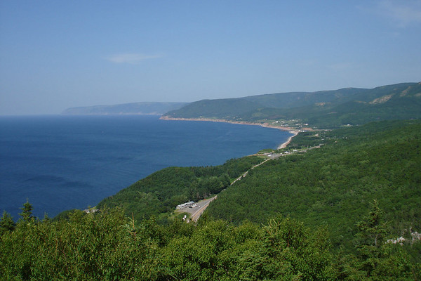 """A commanding view of Pleasant Bay and the Cape Breton Highlands National Park. <div id=""""caption_tourlink"""" align=""""right""""><br>[photo © Chris Benesh]</div>"""