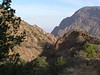 """The Chisos Mountains Basin contains a unique mix of brush vegetation, desert succulents, and piñon forest.  Ascending trails such as the one pictured here increases one's chances of seeing Acorn Woodpeckers and White-throated Swifts.<div id=""""caption_tourlink"""" align=""""right""""> [photo © participants Bill & Nancy Denton]</div>"""