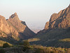 """The Window, a large crevice that cuts through the rim of the Chisos Mountains Basin, provides a stunning view of Big Bend's desert landscapes.  The trail that leads to the edge of the window runs along a small creek and is a likely place to see Mexican Jays and Cactus Wrens. <div id=""""caption_tourlink"""" align=""""right""""> [photo © Chris Benesh]</div>"""
