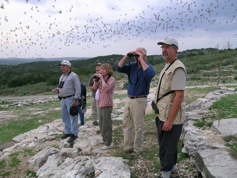 "Our 2007 group with guide John Rowlett (left) at the Rio Frio bat cave. <div id=""caption_tourlink"" align=""right""> [photo © participant Mike Hernandez]</div>"