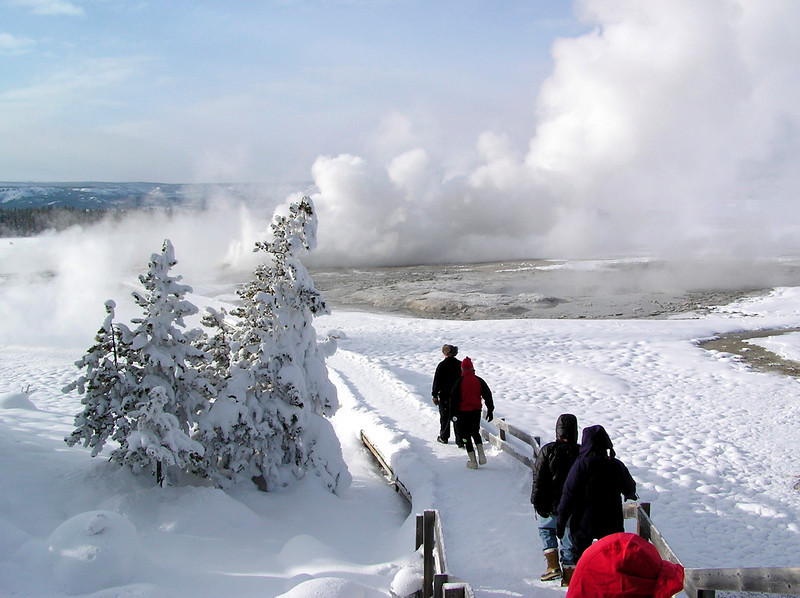 """Checking out Yellowstone's steam vents and boiling pools<div id=""""caption_tourlink"""" align=""""right""""> [photo © participant Bill Denton]</div>"""