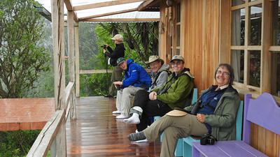 """Where we'd like to be"" #3: On Tony Nunnery's porch in W Ecuador (highest hummer yard list in the world, at 40+ species!) -- in our socks. Photo by participant Charm Peterman."