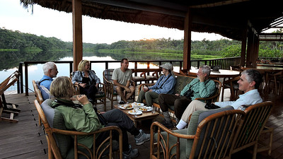 """Where we'd like to be"" #4:  After flight/motorboat ride/canoe paddle, a welcome on the lakeside deck at Ecuador's Sacha Lodge. Photo by guide Willy Perez."