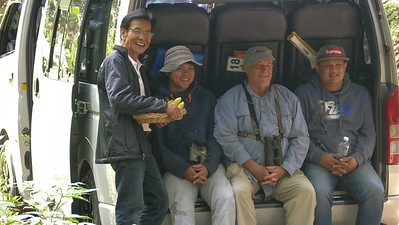 Birders' Helping Hands #2: Participant Bill Thomas hangs out with the world's absolute best birding tour support crew of Wat (l.) and gang in Thailand. Photo by participant Randy Siebert.