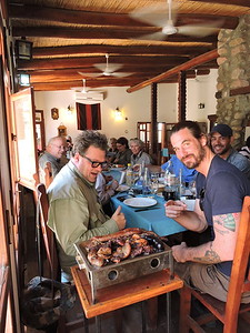 "It's challenging being a vegetarian in Argentina, but if you're a carnivore, well, it's ""churrasco"" heaven! Guide Jesse Fagan and group sIt down to feast in this photo by guide Willy Perez. Pass the chimichurri, please..."
