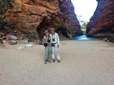 It almost looks like a studio backdrop, but it's for real: beautiful Simpson's Gap, west of Alice Springs. Those two postcard-worthy celebs are our own Grebe and Kingfisher, guides Rose Ann Rowlett and John Coons, co-leading a recent Australia tour. Photo by participant Fred Dalbey.